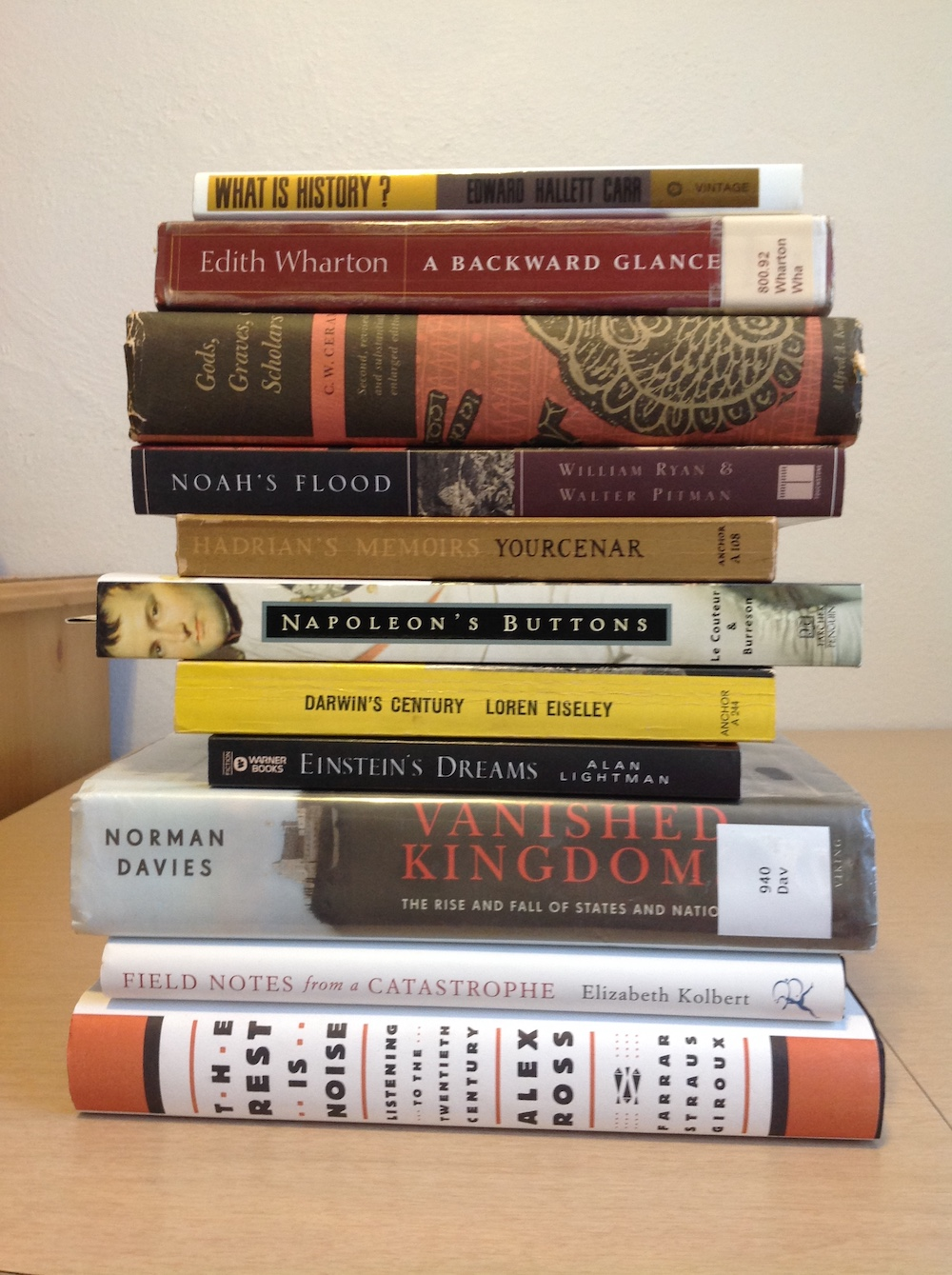 Stack of books, spine forward, where the titles comprise a poem of sorts.